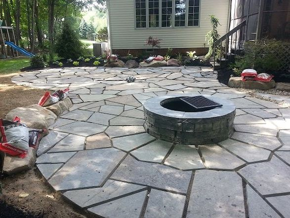 Installation of the bluestone patio and firepit eliminated the areas of water-logged grass.