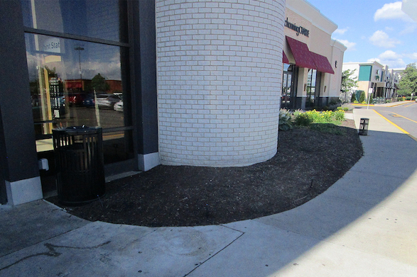 The previous landscaping was removed to make way for our updated design.