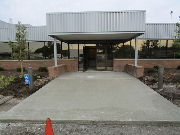 A concrete slab was poured to support the heating element mesh that went under the paver entrance and eliminated ice melt being tracked into the building.