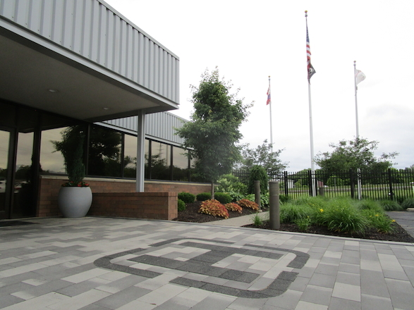 After placing the heating element, we installed pavers that incorporated brand colors and created a paver logo inlay for a striking, functional entrance into the renovated facility.