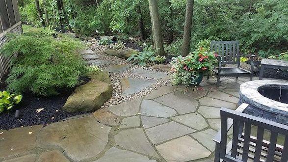 The irregular bluestone and gravel path prevents the previously overwhelmingly marshy conditions while wedding the natural and man-made elements of this design.