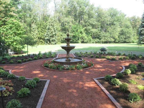 Planting beds and symmetrical patterns add a dynamic element to this landscape