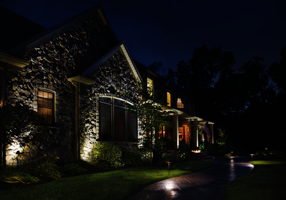 LED landscape lighting lights up the front of a house