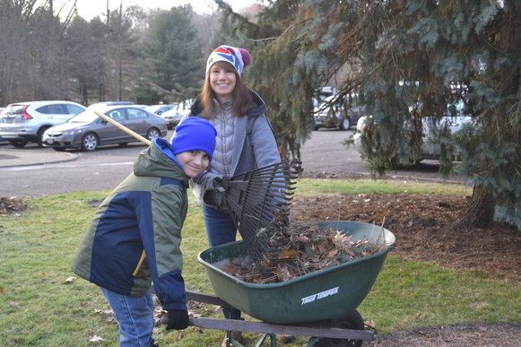 Volunteers raking leaves during Rice's fall clean up at Sancta Clara Monastery