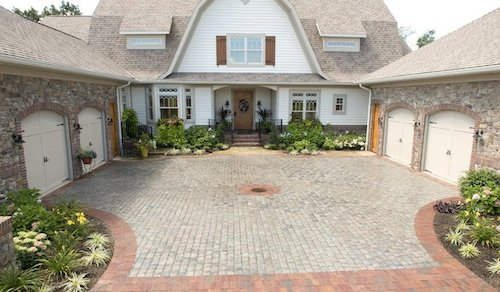 Gorgeous cobblestone driveway enhances the beauty of the property