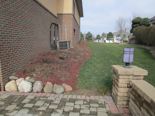 The client desired a sidewalk on the side of the house to allow visitors to access the back patio space from the front driveway without going through the home.