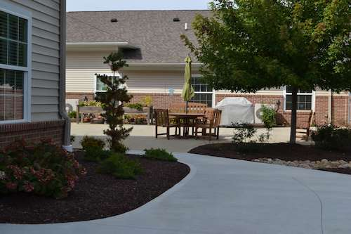 Assisted living facility in Wooster - Landscaping and patio area for residents