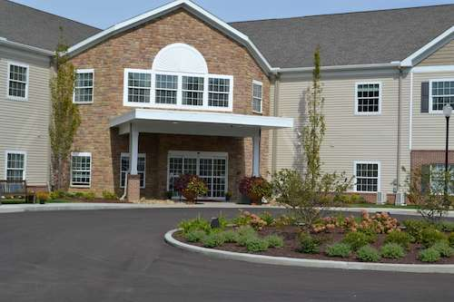 Assisted living facility in Wooster - Landscaping within driveway wraparound and in front of entrance