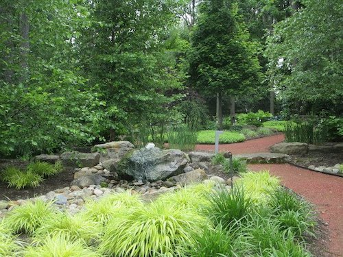 Rocks of various sizes give dimension to this lush garden