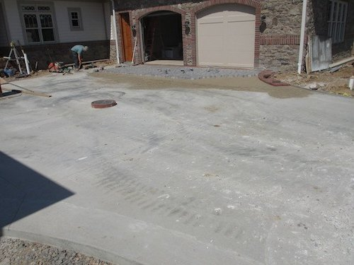 Our experienced installation staff lay the foundation to the cobblestone driveway