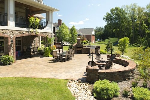 Stamped concrete patios enhance the rich and natural qualities of your outdoor space